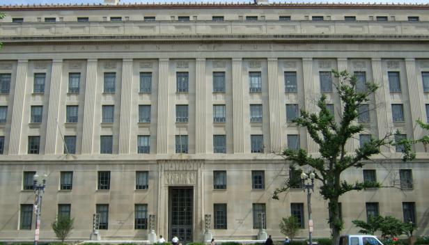 """Front of Department of Justice Building"" by Baseball Watcher licensed under CC BY 3.0."