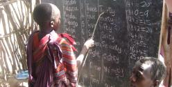 Child and blackboard - Photo by Gideon Granville
