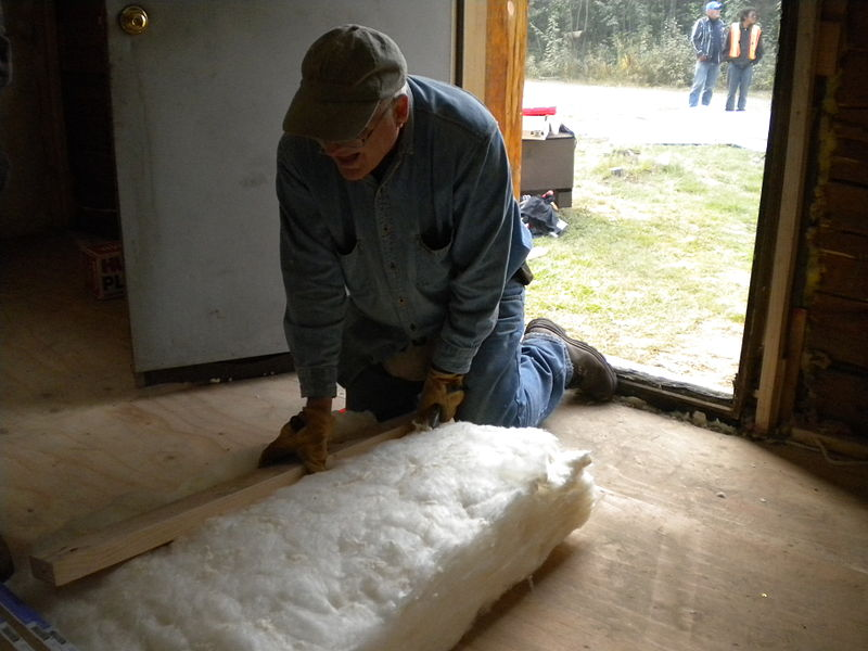 Mennonite Disaster Service (MDS) volunteer De Hon cuts insulation for a home MDS is repairing. They hope to have all of the houses in Stevens Village repaired before winter. - Ben Brennan/ Federal Emergency Management Agency