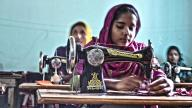 """""""Bangladeshi women sewing clothes"""" by USAID licensed under USA Public Domain."""