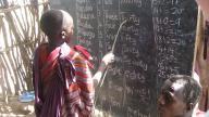Child at blackboard - photo by Gideon Granville