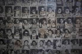 A_Panel_displays_pictures_of_residents_died_in_bhopal_gas_tragedy_photo_credit_Reuters
