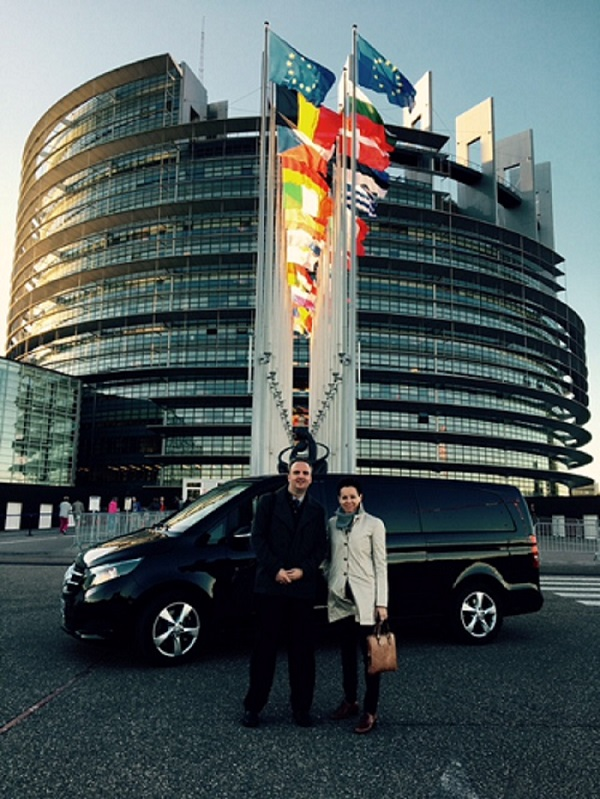 Lea Rankinen and Andy Hall in Brussels in front of the European Parliament
