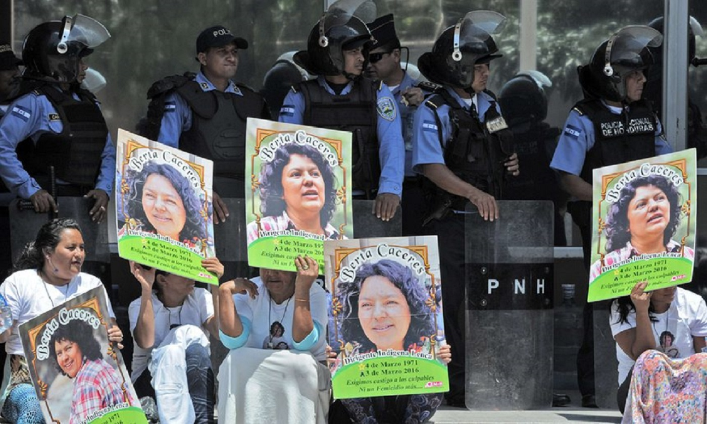 Human rights activists take part in a protest following the murder of Honduran environmental campaigner Berta Cáceres. Photograph: Orlando Sierra/AFP/Getty