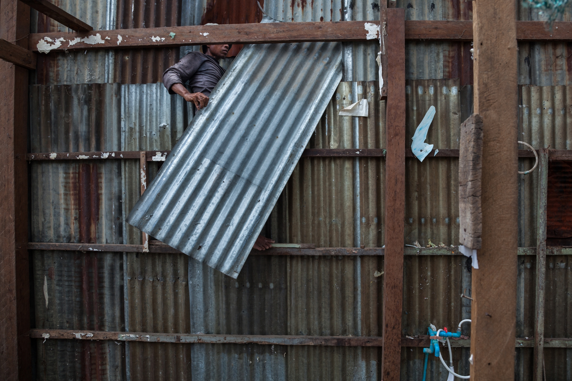 transitioning photo essay of rapid developments in 23 2010 phnom penh a worker dismantles a house on boeung kak residents had the option of accepting 8500 dollars in compensation or