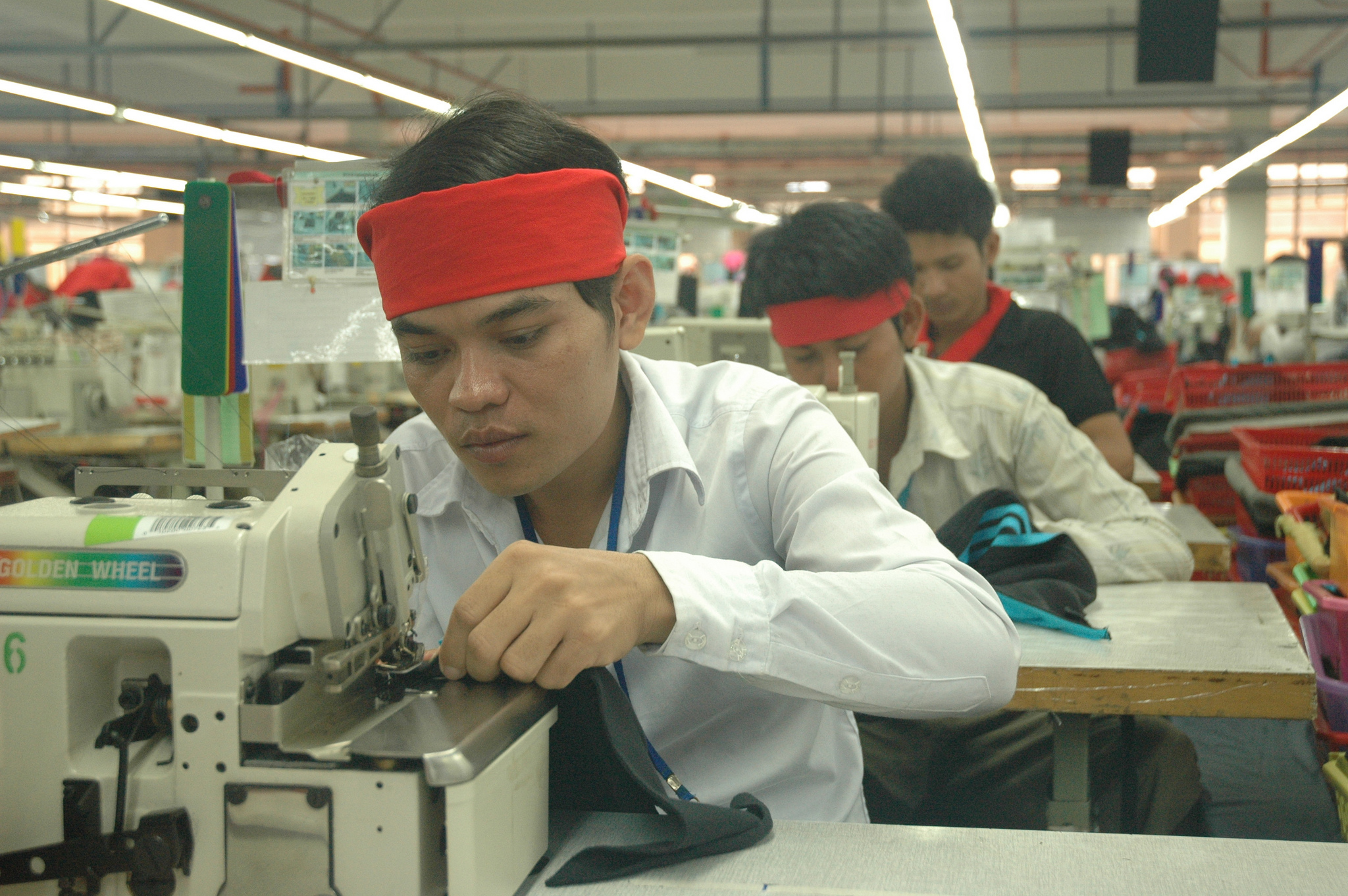 Male garment worker in a factory in Cambodia