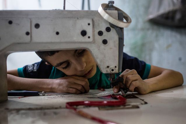 Syrian_refugee_shoe_workshop_Turkey_ArabianBusiness.com_GettyImages