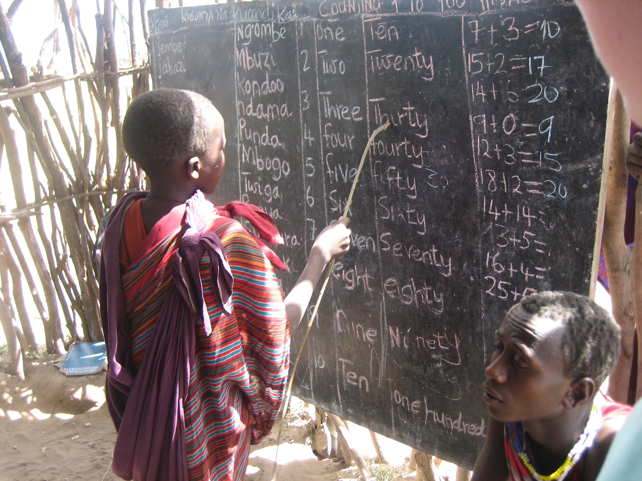 child at blackboard - photo by Gideon Granville