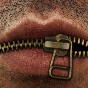 AR Images, Shutterstock: Mouth with zip
