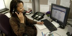 Professional woman answering the phone