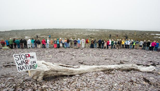 Line of people protesting a pipeline in the United States