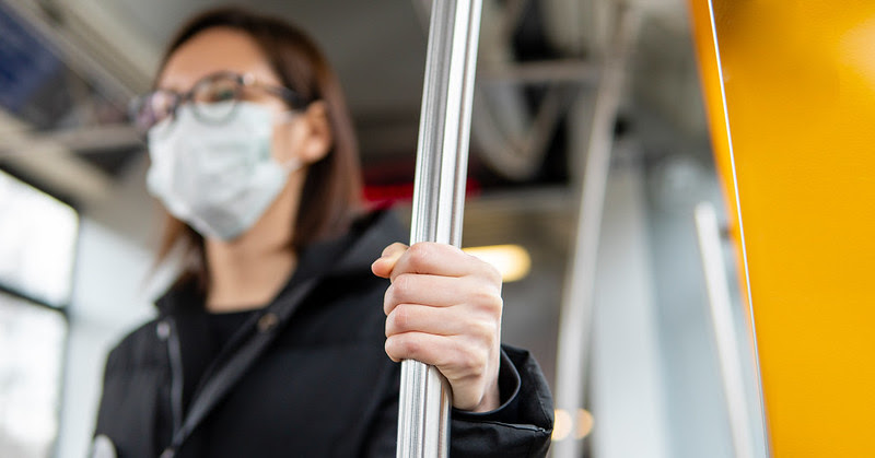 Woman wearing face mask on public transport